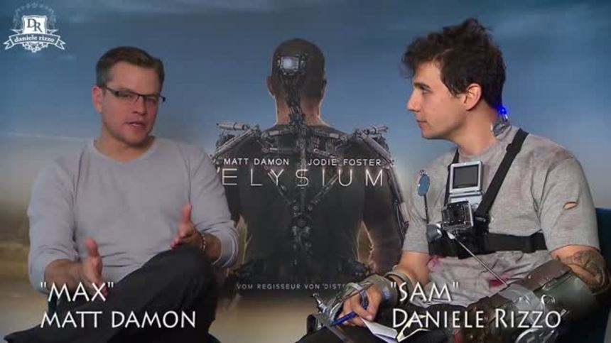 """Watch: Matt Damon And Lilly Collins Meet Daniele Rizzo As """"Sam"""" And The Wolfster, Respectively"""