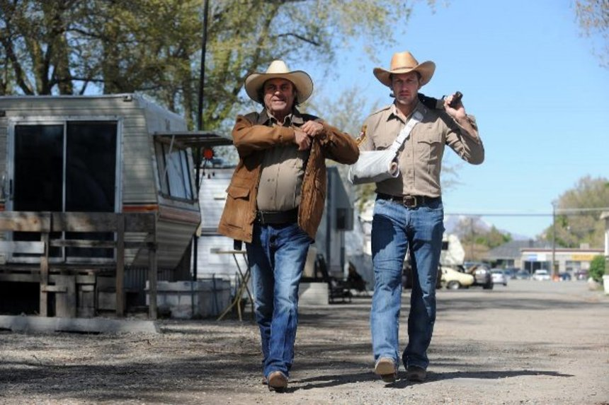 THE MAN ON CARRION ROAD: Ian McShane And Patrick Wilson Don Hats, Firearms, And Jeans